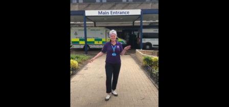 Keyworker taps for charity outside hospital